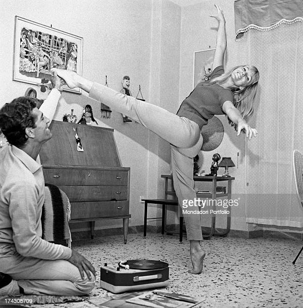 Italian dancers choreographer and actors Elena Sedlak and Paolo Gozlino practising together some steps 1960