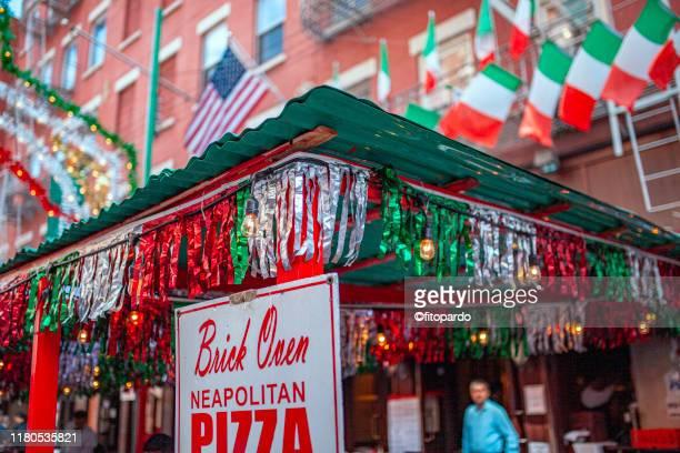 italian decoration outside buildings in little italy - little italy new york foto e immagini stock