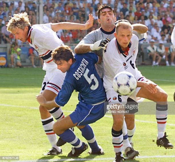 Italian defender Alessandro Costacurta and goalkeeper Gianluca Pagliuca is challenged by Norwegians Vidar Riseh and Stale Solbakken 27 June at the...