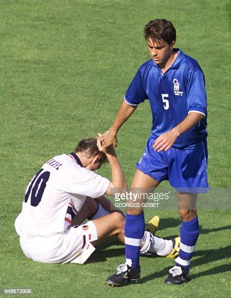 Italian defender Alessandro Costacurta comforts Norvegian Ketil Rekdal at the end of their game won 10 by Italy 27 June at the Stade Velodrome in...