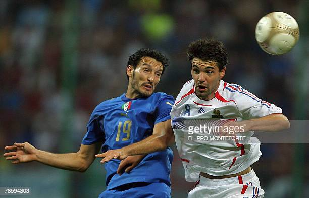 Italian defender Gianluca Zambrotta fights for the ball with French midfielder Jermey Toulalan during their Euro 2008 qualifier football match Italy...