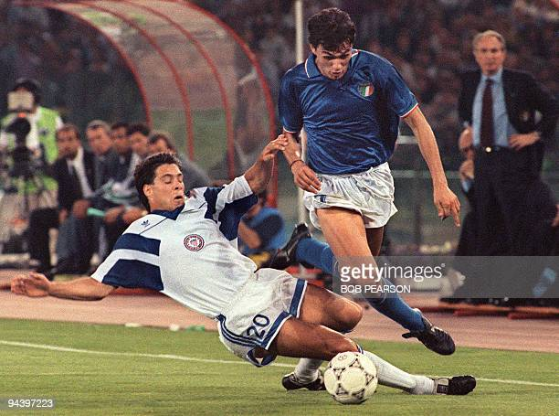 Italian defender Paolo Maldini is tackled by US midfielder Paul Caliguri during their 90 soccer World Cup match 14 June 1990 in Rome AFP PHOTO BOB...
