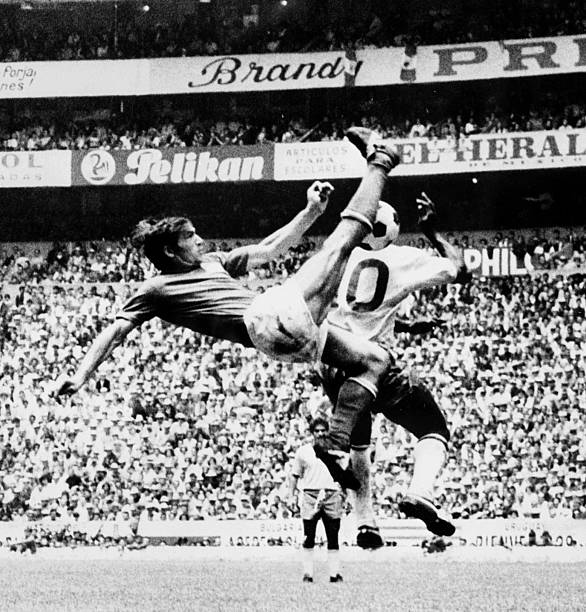 Italian defender Tarcisio Burgnich kicks the ball away from Brazilian midfielder Pele during the World Cup final between Brazil and Italy 21 June...