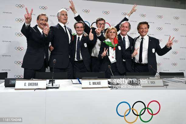 Italian delegation members pose prior to sign the contract after the Milan/Cortina d'Ampezzo was elected to host the 2026 Olympic Winter Games during...