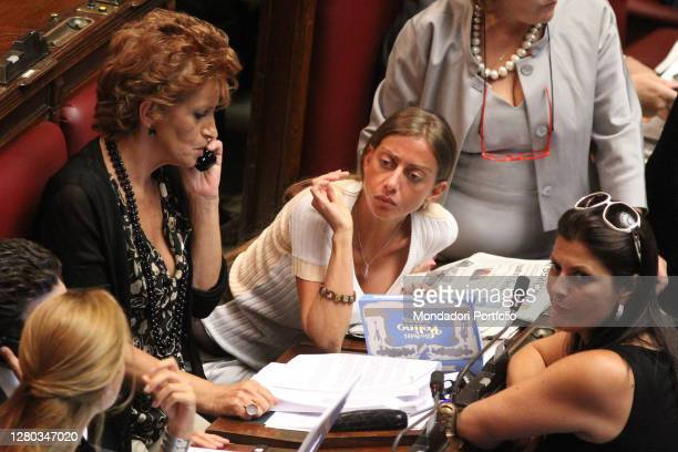 Italian deputies Paola Pelino, Mariarosaria Rossi and Jole Santelli while discussing in the Chamber of Deputies for the vote of confidence in the...