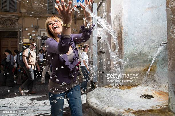 Italian deputy Alessandra Mussolini splashing with the water of a fountain Rome 27th April 2012
