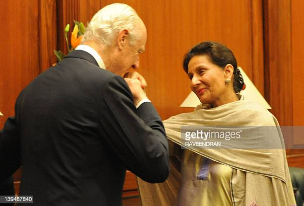 Italian Deputy Foreign Minister Staffan De Mistura kisses the hand of Indian Minister of State for External Affairs Preneet Kaur during a meeting at...