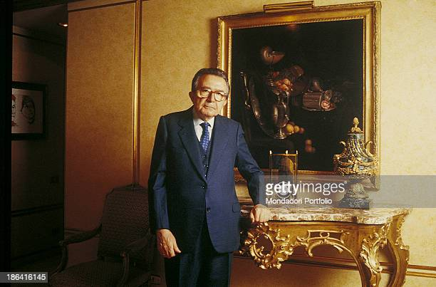 Italian deputy Giulio Andreotti posing leaned on a rococo table in front of a still life painting 1993