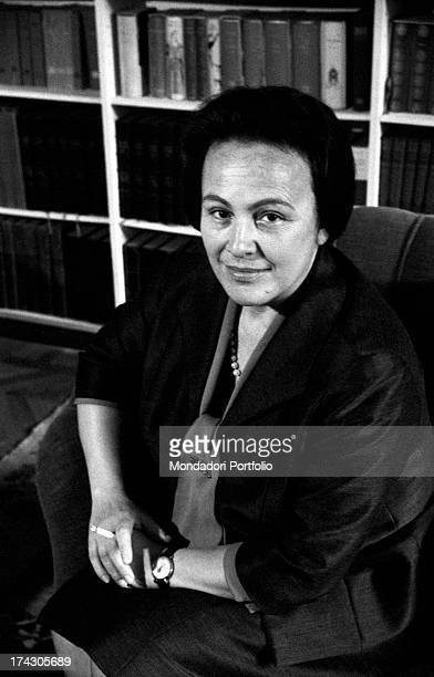 Italian deputy Nilde Iotti sitting on an armchair smiling. Rome, 1964.