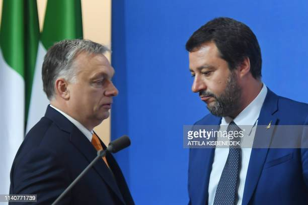 Italian Deputy Premier and Interior Minister Matteo Salvini arrives with the Hungarian Prime Minister Viktor Orban to address a press conference in...