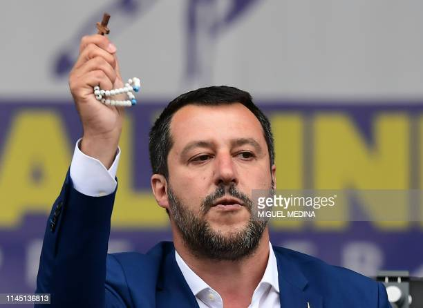 Italian Deputy Prime Minister and Interior Minister Matteo Salvini delivers a speech holding a rosary during a rally of European nationalists ahead...