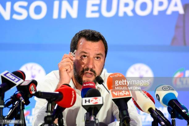 Italian Deputy Prime Minister and Interior Minister Matteo Salvini delivers a press conference holding a rosary after the announcement of initial...