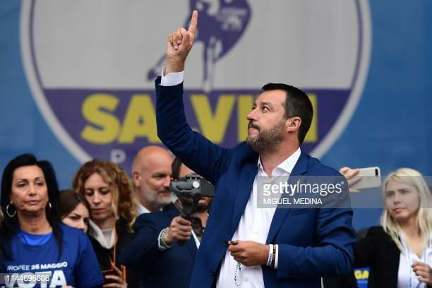 Italian Deputy Prime Minister and Interior Minister Matteo Salvini gestures on stage during a rally of European nationalists ahead of European...