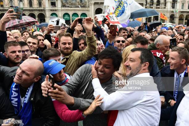 Italian Deputy Prime Minister and Interior Minister Matteo Salvini poses for a selfie during a rally of European nationalists ahead of European...