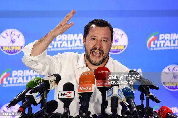 TOPSHOT Italian Deputy Prime Minister and Interior Minister Matteo Salvini gestures as he speaks during a press conference in the Lega headquarters...