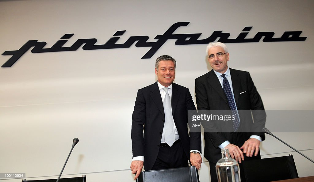 Italian design studio head and Pininfarina President Paolo Pininfarina (L) and Pininfarina CEO Silvio Pietro Angori pose before a conference as part of the 80th anniversary of the Pininfarina Italian car maker group in Cambiano near Turin on May 21, 2010.