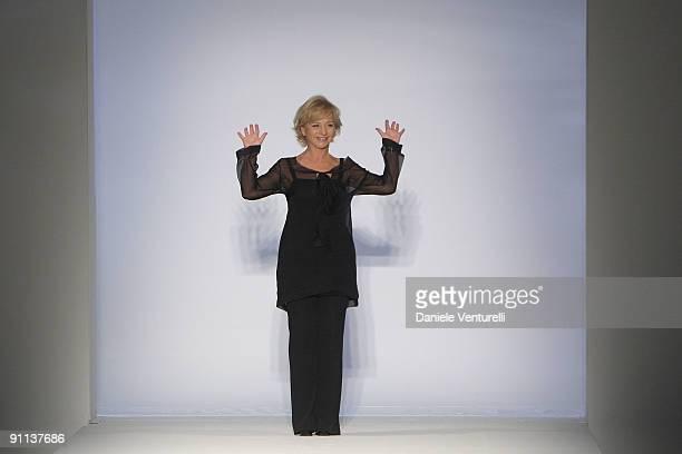 Italian designer Alberta Ferretti acknowledges the applause of the audience after the Alberta Ferretti show as part of Milan Womenswear Fashion Week...