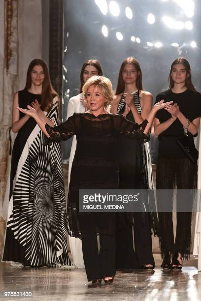 Italian designer Alberta Ferretti greets the audience after her women's Spring collection fashion show in Milan on June 15 2018