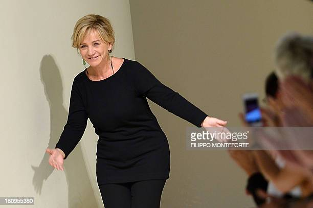Italian designer Alberta Ferretti greets the audience at the end of her show as part of the spring/summer 2014 readytowear collections during the...