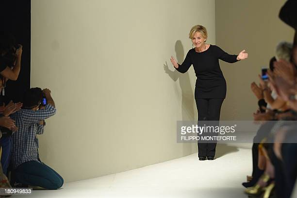 Italian designer Alberta Ferretti waves at the end of her show as part of the spring/summer 2014 readytowear collections during the fashion week in...