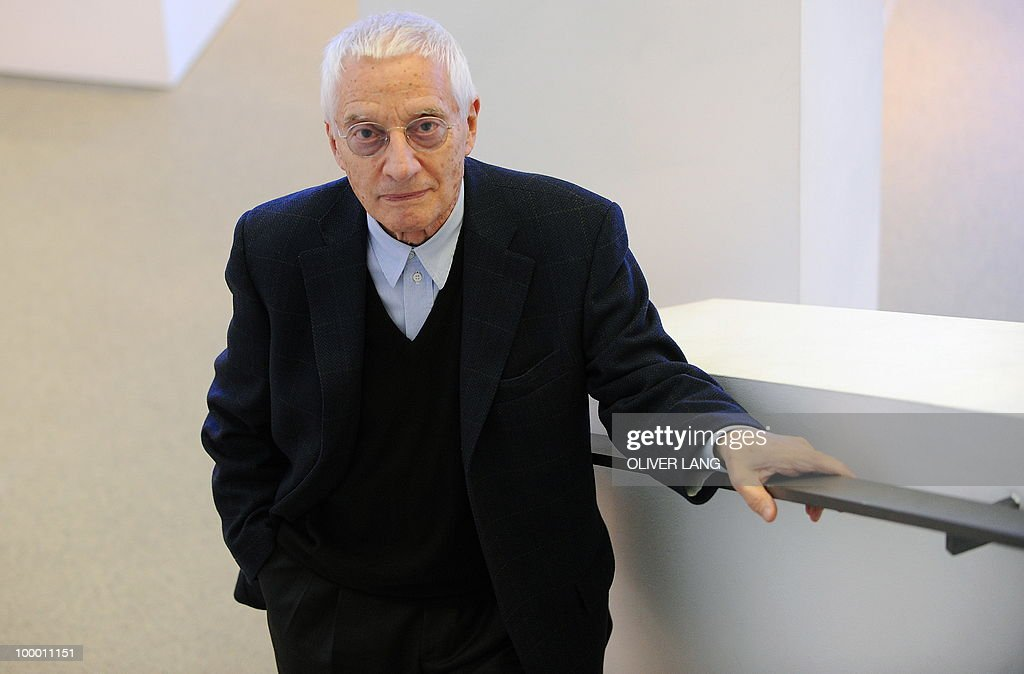 Italian designer Alessandro Mendini poses during a press preview of the exhibition 'Oggetti e Progetti - Alessi: storia e futuro di una fabbrica del design italiano' on May 20, 2010 at the Neue Sammlung (New Collection) museum in Munich, southern Germany. From May 22 to September 19, 2010, the museum presents a retrospective of the last 30 years of Italian design, focusing on a key player in the design world: the Alessi company.