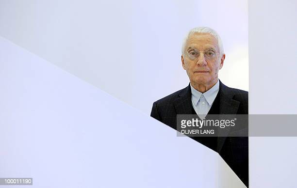 Italian designer Alessandro Mendini poses during a press preview of the exhibition Oggetti e Progetti Alessi storia e futuro di una fabbrica del...