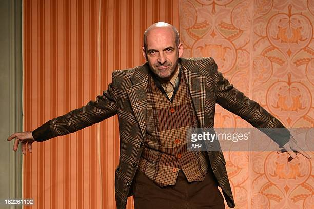 Italian designer Antonio Marras acknowledges the audience at the end of his FallWinter 20132014 Womenswear collection on February 21 2013 during the...