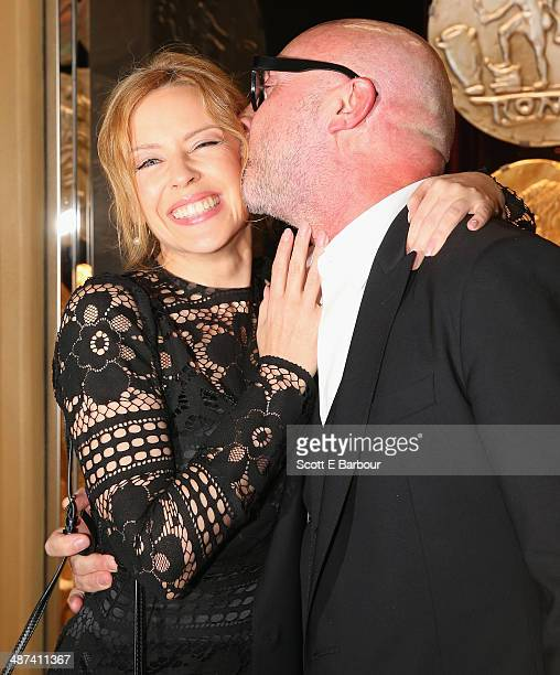 Italian designer Domenico Dolce and Australian singer Kylie Minogue kiss as they arrive at the Dolce Gabbana Store party on Collins Street on April...
