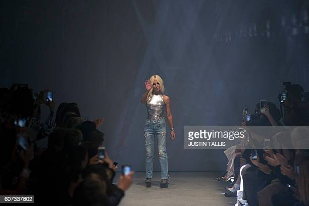 Italian designer Donatella Versace acknowledges the audience after Versace's Versus label showing during the 2017 Spring / Summer catwalk show at...