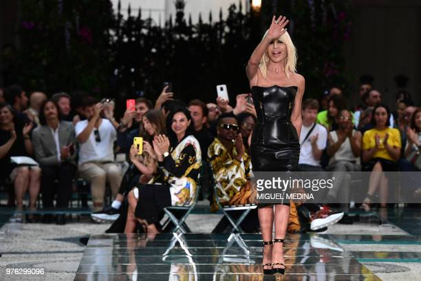 Italian designer Donatella Versace acknowledges the audience at the end of the Versace men women's spring/summer 2019 collection fashion show in...