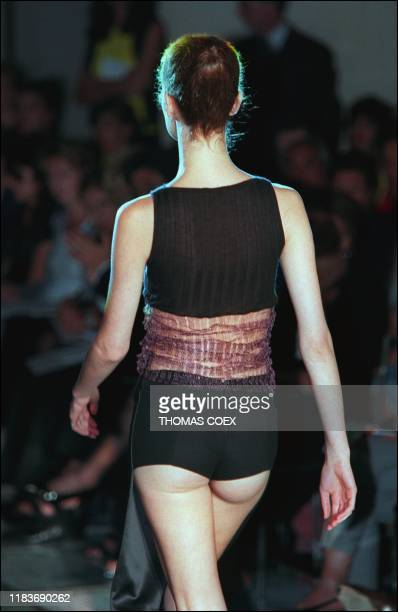 Italian designer Donatella Versace showed this model sheer and short in the back during the 1998/99 Fall/Winter high fashion collection in Paris It...