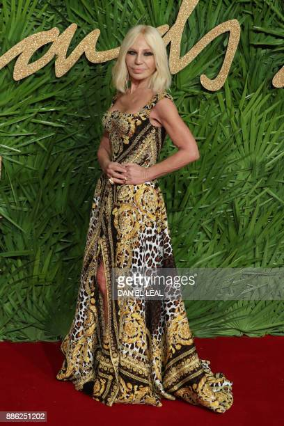 Italian designer Donatella Versace who won the fashion icon award poses on the red carpet upon arrival to attend the British Fashion Awards 2017 in...