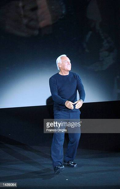 Italian designer Giorgio Armani acknowledges the applause at the end of his Spring/Summer women's collection for 2003 September 30 2002 in Milan Italy