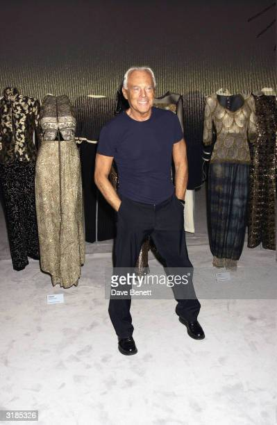 Italian designer Giorgio Armani attends the Giorgio Armani Retrospective at the Royal Academy posing with the Mercedes Benz and Armani clothing used...