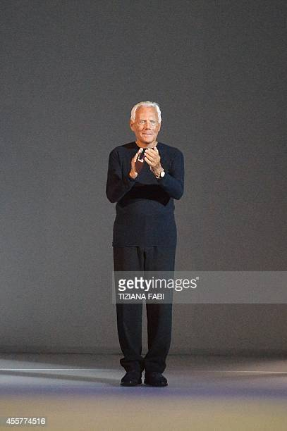 Italian designer Giorgio Armani greets the audience at the end of his show during the 2015 Spring / Summer Milan Fashion Week on September 20 2014 in...
