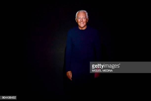 Italian designer Giorgio Armani greets the audience at the end of the show Emporio Armani during the Men's Fall/Winter 2019 fashion shows in Milan on...