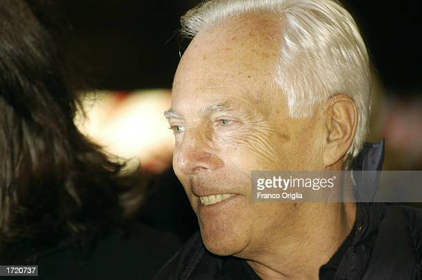 Italian designer Giorgio Armani poses for photographers during red carpet arrivals for the Italian premiere of director Martin Scorsese's film 'Gangs...