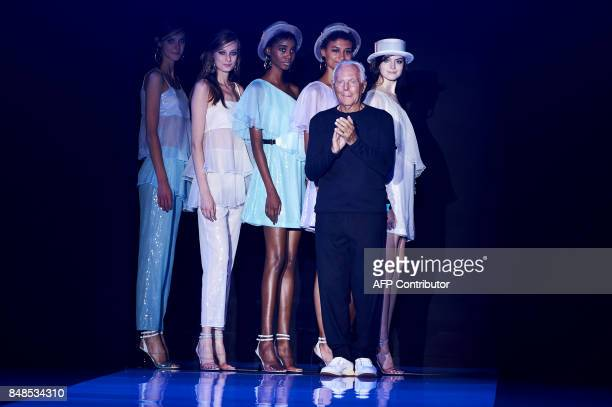 TOPSHOT Italian designer Giorgio Armani takes to the stage after the fashion house Emporio Armani catwalk show for the Spring/Summer 2018 collection...