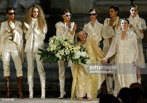 Italian designer Laura Biagiotti smiles next to Italian dancer Carla Fracci at the end of her fashion show as part of 2004/2005 Fall/Winter...