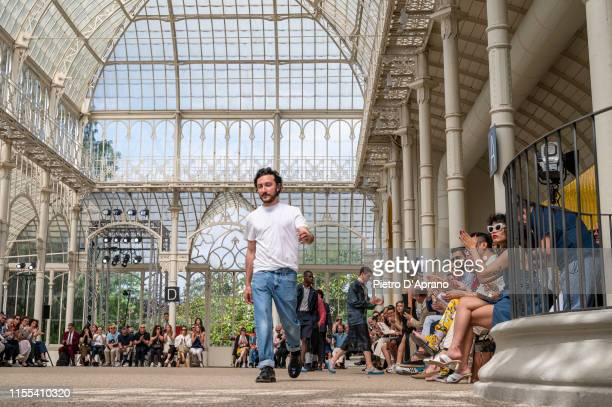 Italian Designer Marco de Vincenzo acknowledges the applause of the public after the Marco De Vincenzo fashion show during Pitti Immagine Uomo 96 on...