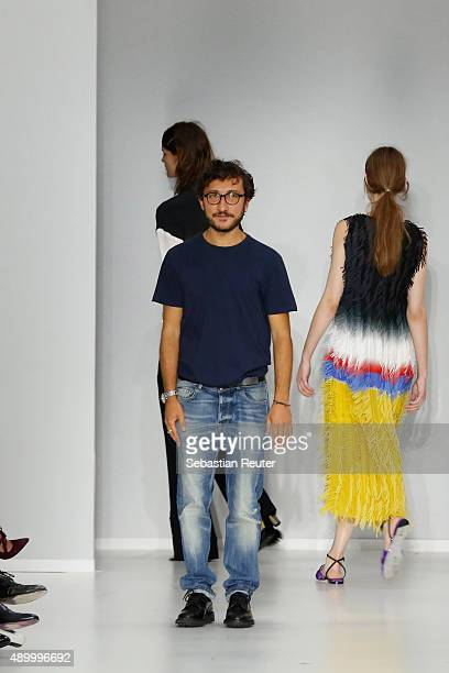 Italian Designer Marco de Vincenzo acknowledges the applause of the public afterg the Marco De Vincenzo fashion show as part of Milan Fashion Week...