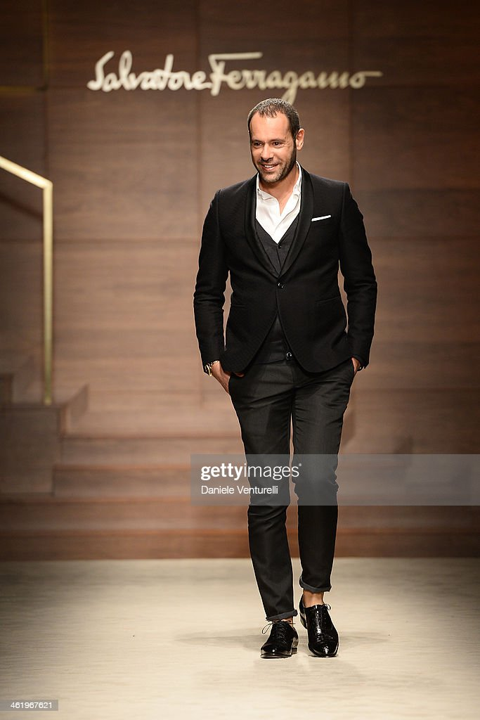 Italian designer Massimiliano Giornetti acknowledges the applause of the public after the Salvatore Ferragamo show as a part of Milan Fashion Week Menswear Autumn/Winter 2014 on January 12, 2014 in Milan, Italy.