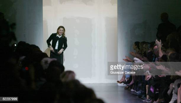 Italian designer Miuccia Prada acknowledge the applause at the Miu Miu fashion show as part of Milan Fashion Week Autumn/Winter 2005/6 on February 24...