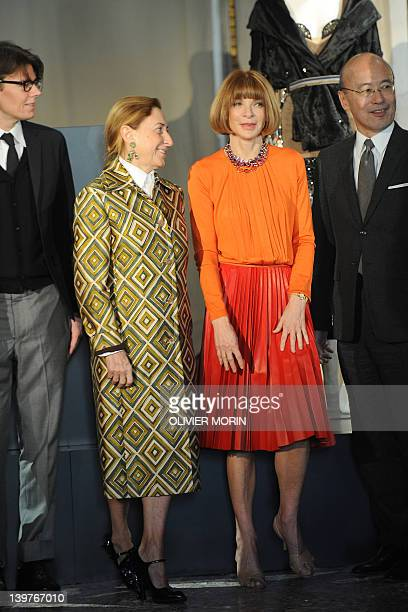 Italian designer Miuccia Prada and US Vogue editorinchief Anna Wintour are flanked by curators Harold Koda and Andrew Bolton as they pose during a...