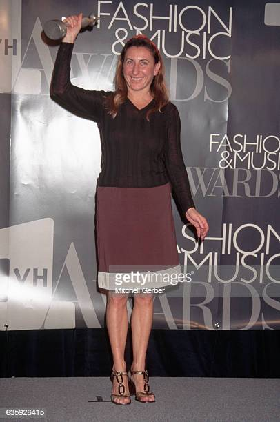 Italian designer Miuccia Prada holds her trophy from the VH-1 Fashion and Music Awards.