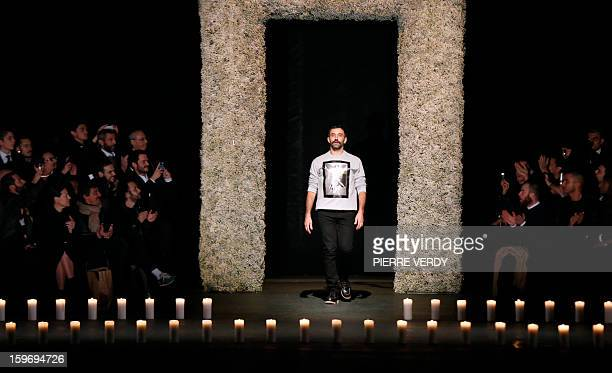 Italian designer Riccardo Tisci acknowledges the audience at the end of his men's fallwinter 20132014 fashion collection show for Givenchy on January...