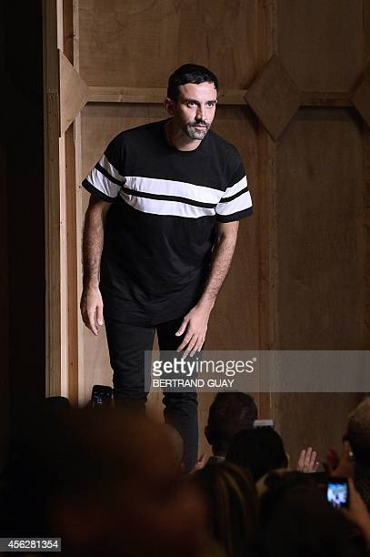 Italian designer Riccardo Tisci acknowledges the audience at the end of the Givenchy 2015 Spring/Summer ready-to-wear collection fashion show, on...