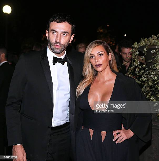Italian designer Riccardo Tisci and US socialite Kim Kardashian attend the 'Mademoiselle C' cocktail party at the Pavillon Ledoyen on October 1 2013...