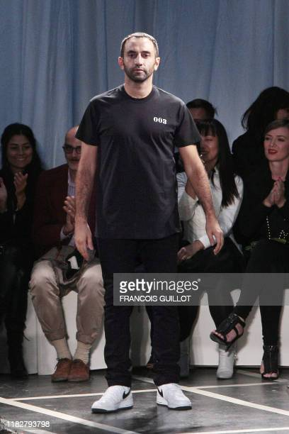 Italian designer Riccardo Tisci for Givenchy at the end of his ready-to-wear Spring-Summer 2010 fashion show on October 4, 2009 in Paris. AFP PHOTO...