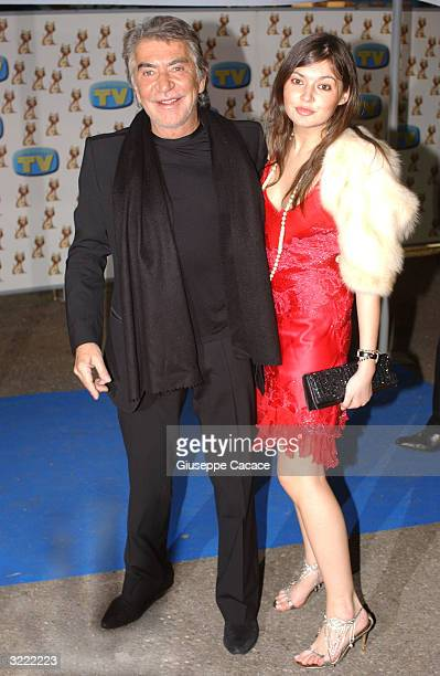 Italian designer Roberto Cavalli and his daughter Rachele arrive for the XXI International Television Awards ceremony on April 5 2004 at the Mazda...
